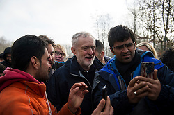 © Licensed to London News Pictures. 23/01/2016. Dunkirk, France. Leader of the Labour Party JEREMY CORBYN poses for a selfie while meeting migrants during a visit to a temporary camp in Dunkirk, France, where thousands of migrants and refugees attempting to reach the UK are currently living. Photo credit: Ben Cawthra/LNP