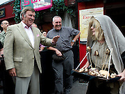 """The Headless Kings presented an re-enactment of """"The King's Head"""" at the pub of the same name in Galway City  for Terry Wogan's Ireland a 2 part BBC programme by the Limerick man and BBC presenter. Here a Claddagh woman fishwife sells king's head replicas for 5 shilling as Sir Terry Wogan Looks on. Photo:Andrew Downes"""