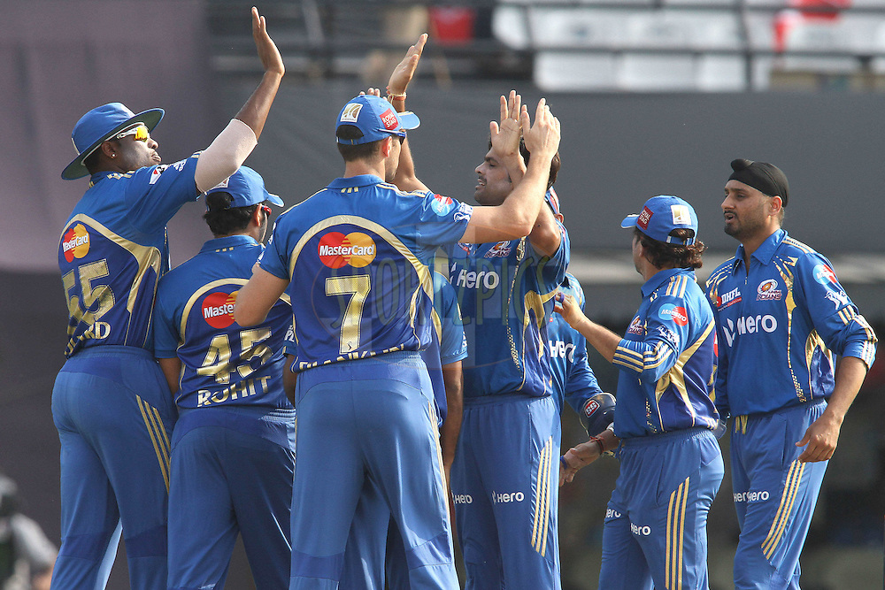 Mumbai Indians celebrate Mandeep Singh of the Kings XI Punjab wicket during match 33 of the the Indian Premier League (IPL) 2012  between The Kings X1 Punjab and The Mumbai Indians held at the Punjab Cricket Association Stadium, Mohali on the 25th April 2012..Photo by Shaun Roy/IPL/SPORTZPICS