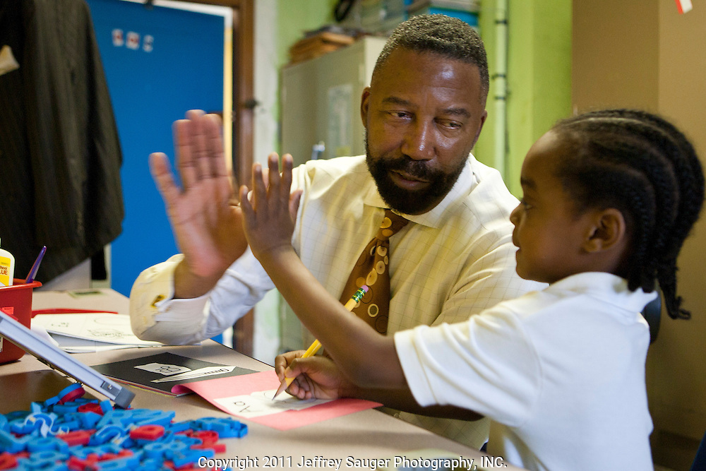 DETROIT, MI - NOVEMBER, 16: Robert C. Bobb, Emergency Financial Manager of Detroit Public Schools, left, high-fives Darrell Gigsby III, right, at Thirkell Elementary School, in Detroit, MI, Tuesday, November 16, 2010. Bobb tutors two kindergarteners every week as a volunteer in the DPS Reading Corps. (Photo by Jeffrey Sauger)