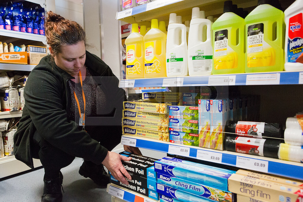 "© Licensed to London News Pictures. 19/12/2014. London, UK. A member of staff fills the shelves in the Community Shop with cleaning products. The Community Shop opened this week in Gipsy Hill, South London and is a ""social supermarket"", which sells heavily-discounted surplus food that would otherwise be thrown away. Food is received from retail brands such as Marks & Spencer, Asda, Tesco, Innocent and Muller and many more. The shop works on a membership basis only, serving residents who are on income support and aimed at people who are in work, but low waged and for those working hard to find a job. Photo credit : Vickie Flores/LNP"