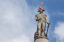 © licensed to London News Pictures. London, UK 30/07/2012. Nelson's Column in Trafalgar Square wears a union jack hat with the Olympic torch cut out on 30/07/12 in central London. Photo credit: Tolga Akmen/LNP