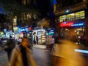 25 DECEMBER 2017 - HANOI, VIETNAM: Evening traffic on Ly Quoc Su Street in the Old Quarter of Hanoi.     PHOTO BY JACK KURTZ