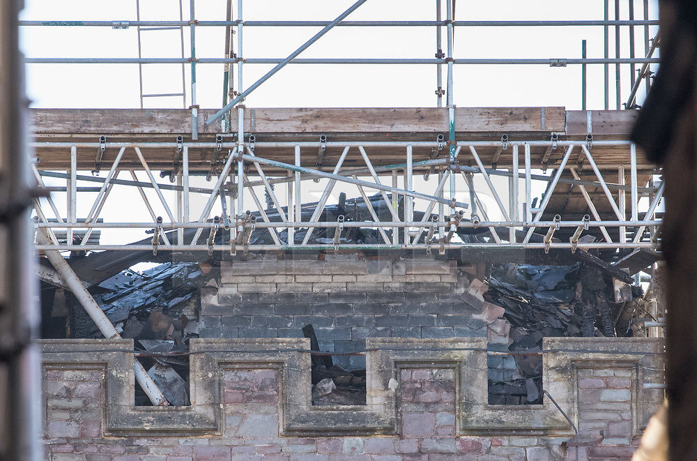 © Licensed to London News Pictures. 07/01/2018. Bristol, UK.  Damage to the roof of the Fry Building at the University of Bristol, following a fire on the evening of 06/01/2018. The building has been undergoing refurbishment and was due to open for students in September this year. The fire started on the top floor of the five-storey building, and Avon Fire and Rescue sent multiple fire appliances to the scene including two turntable ladders. No one was in the building when the fire started and there were no injuries.  Photo credit: Simon Chapman/LNP