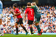 Manchester City Women goalkeeper Ellie Roebuck (26) hugs Manchester United Women forward Ella Toone (7) during the FA Women's Super League match between Manchester City Women and Manchester United Women at the Sport City Academy Stadium, Manchester, United Kingdom on 7 September 2019.