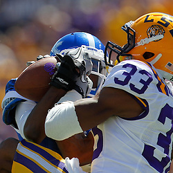 October 1, 2011; Baton Rouge, LA, USA;  LSU Tigers wide receiver Odell Beckham (33) and Kentucky Wildcats cornerback Anthony Mosley (14) fight for possession of a catch during the fourth quarter at Tiger Stadium. LSU defeated Kentucky 35-7. Mandatory Credit: Derick E. Hingle-US PRESSWIRE / © Derick E. Hingle 2011