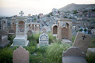 The cemetery in the Assyrian town of Al-Qosh overlooking the Nineveh Plain in Northern Iraq. The town was established more than 2500 years ago and was one of the first to adopt Christianity in the first century AD. The Iraqi Christian community is thought to be one of the longest coninuous Christian communities in the world. Violence, persecution and sectarian strife have forced two thirds of Iraqi Christians to flee the country in recent years and many more to be displaced to the relative security of Iraqi Kurdistan. Al Qosh, Iraq. 19/04/2014.