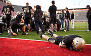 Lone Peak senior Josh Buck (40) lays on the ground following their loss in the Utah State High School 5A Football semifinal between Lone Peak and Jordan in Rice-Eccles Stadium, Thursday, Nov. 8, 2012.