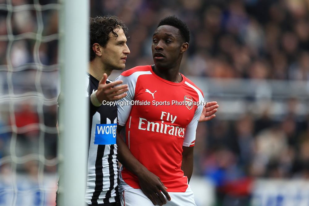 21 March 2015 - Barclays Premier League - Newcastle United v Arsenal - Danny Welbeck of Arsenal tangles with Daryl Janmaat of Newcastle United - Photo: Marc Atkins / Offside.