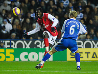 Photo: Leigh Quinnell/Sportsbeat Images.<br /> Reading v Arsenal. The FA Barclays Premiership. 12/11/2007. Arsenals Emmanuel Adebayor gets a cross past Readings Brynjar Gunnarsson.