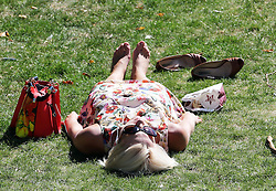 A woman enjoys the Indian summer in Green Park, London,  Monday, 2nd September 2013. Picture by Stephen Lock / i-Images
