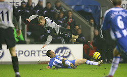 WIGAN, ENGLAND - TUESDAY, JANUARY 31st, 2006: Everton's Tony Hibbert and Wigan Athletic's David Thompson during the Premiership match at the JJB Stadium. (Pic by David Rawcliffe/Propaganda)