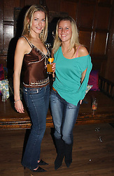 Left to right, MISS SOPHIE JOHNSTONE and MISS LUCY AUSTIN at a party to celebrate the 4th anniversary of Quintessentially held at 11 Grosvenor Place, London  SW1 on 14th December 2004.<br /><br />NON EXCLUSIVE - WORLD RIGHTS