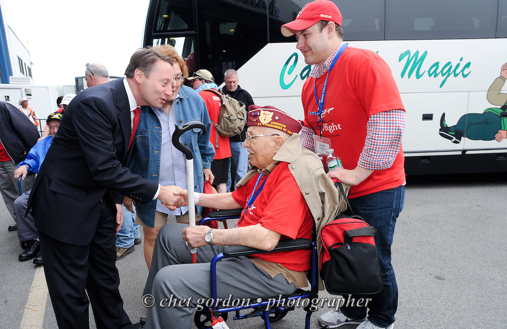 WWII Veterans and their escorts during the sendoff ceremony for the Hudson Valley Honor Flight #8 at Westchester  County Airport in White Plains, NY on Saturday, May 9, 2015. Sixty-six veterans from the Westchester County (NY) area toured the WWII and Marine Corps War Memorials, as well as Arlington National Cemetery. Hudson Valley Honor Flight is a chapter of the Honor Flight Network, which provides free flights for WWII Veterans and tours of the WWII Memorial constructed in their honor, and other sites in the nation's capital.  © Chet Gordon / Hudson Valley Honor Flight
