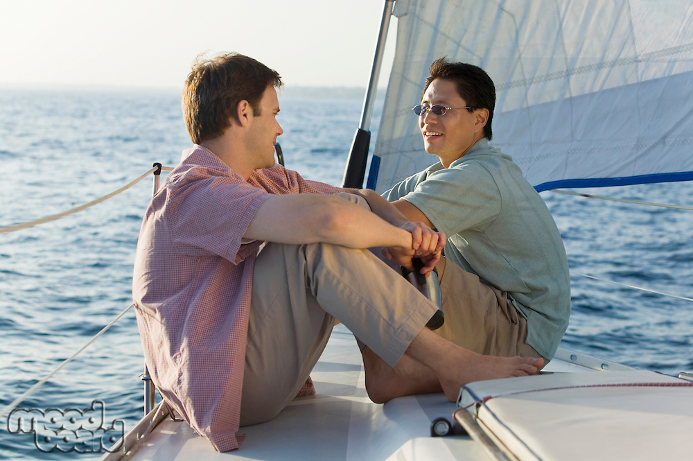 Friends Sitting on Sailboat
