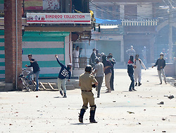 June 16, 2017 - Srinagar, Jammu and Kashmir, India - Youth Clash with Indian Forces in Srinagar during the .protests against the killing of a civilian and a rebel in Kashmir on Friday. A rebel .Junaid Mattoo was killed in an Encounter with Indian Forces in Arwani area of Kulgam .District of Kashmir  today. Soon after the killing clashes erupted in whole valley which .left several injured in police action. (Credit Image: © Muzamil Mattoo/Pacific Press via ZUMA Wire)