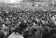 Woodstock Rock Festival fans waiting in the rain for the next act to play at the Woodstock rock festival at Max Yasgur's 600 acre farm, in the rural town of Bethel, NY, on the weekend of August 16-18, 1969..