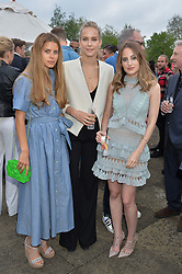 Left to right, IRENE FORTE, HUM FLEMING and ROSIE FORTESCUE at a party to launch the Taylor Morris Explorer Collection held at the Serpentine Lido, Hyde Park, London on 11th May 2016.