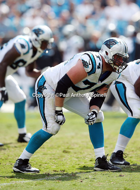 Carolina Panthers tackle Mike Remmers (74) gets set to block during the 2015 NFL week 2 regular season football game against the Houston Texans on Sunday, Sept. 20, 2015 in Charlotte, N.C. The Panthers won the game 24-17. (©Paul Anthony Spinelli)