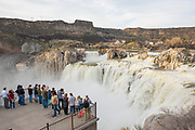 Crowd of people viewing Shoshone Falls from the lookout during really high water, spring run-off. Twin Falls, Idaho.
