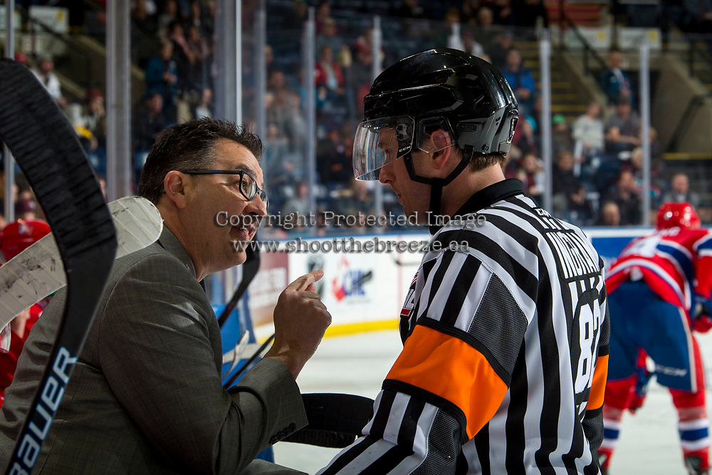 KELOWNA, CANADA - MARCH 13:  Spokane Chiefs' head coach Dan Lambert speaks to referee Jeff Ingram at the bench after a no goal call against the Kelowna Rockets on March 13, 2019 at Prospera Place in Kelowna, British Columbia, Canada.  (Photo by Marissa Baecker/Shoot the Breeze)