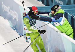 PYEONGCHANG-GUN, SOUTH KOREA - FEBRUARY 15: Second placed Jakov Fak of Slovenia hugs a coach during the mens Biathlon 20k individual start at Alpensia Biathlon Centre on February 15, 2018 in Pyeongchang-gun, South Korea.  Photo by Chine Nouvelle/SIPA