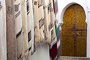 Fez, Morocco - 3rd FEBRUARY 2018 - Moroccan doorway with decorative carpets and rugs hanging on the wall, old Fez Medina, Morocco.