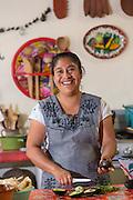 Oaxacan chef Reyna Mendoza Ruíz of El Sabor Zapoteco Cooking School hand makes traditional food in her kitchen in Teotitlan, Mexico.