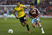 Andre Gray of Burnley tries to get past Emilio Nsue of Middlesbrough during the Sky Bet Championship match between Burnley and Middlesbrough at Turf Moor, Burnley, England on 19 April 2016. Photo by Simon Brady.