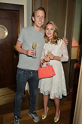 GEORGE FROST and CAGGIE DUNLOP at a private view of the Beulah Winter Autumn Winter collection entitled 'Chrysalis' held at The South Kensington Club, London SW7 on 24th September 2015.
