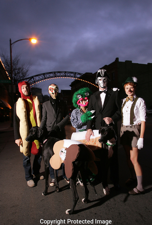 Business owners and friends prepare for the High Ball event Saturday night in the Short North.(Jodi Miller/Alive).Hot Dog Mike Nosan.Long Nose: Ryan Morgan.Monster: Rachel Annarino.Silver Mask Charly Baner.Pinochio: Hannah Adkins.Dogs: Solmon and Sadie