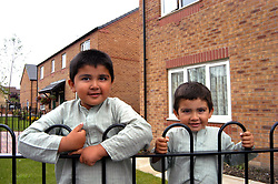 Two brothers outside their Housing Association home; Halifax; Yorkshire UK