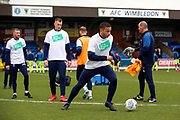 AFC Wimbledon defender Rod McDonald (4) warming up during the EFL Sky Bet League 1 match between AFC Wimbledon and Bolton Wanderers at the Cherry Red Records Stadium, Kingston, England on 7 March 2020.