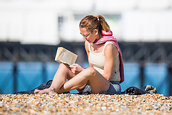 © Licensed to London News Pictures. 06/05/2018. Brighton, UK. Members of the public enjoy the early morning sunshine on the promenade in Brighton and Hove as warm weather continues the seaside resort. Photo credit: Hugo Michiels/LNP