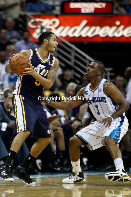 April 11, 2011; New Orleans, LA, USA; Utah Jazz point guard Devin Harris (5) is guarded by New Orleans Hornets point guard Chris Paul (3) during a game at the New Orleans Arena. The Jazz defeated the Hornets 90-78.  Mandatory Credit: Derick E. Hingle
