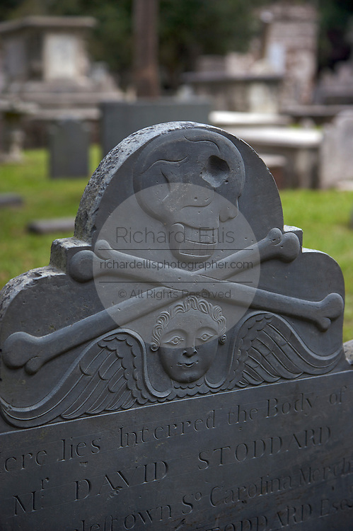 A skull and cross bone grave marker at the Circular Congregational Church cemetery in Charleston, SC. Charleston founded in 1670 is considered America's most beautifully preserved architectural and historic city.