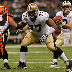 2009 August 14: New Orleans Saints guard Carl Nicks (77) blocks Cincinnati Bengals defensive tackle Domata Peko (94) during a preseason opener between the Cincinnati Bengals and the New Orleans Saints at the Louisiana Superdome in New Orleans, Louisiana.