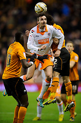 Blackpool Midfielder Angel (ESP) and Wolves Midfielder Stephen Hunt (IRL) compete in the air during the second half of the match - Photo mandatory by-line: Rogan Thomson/JMP - Tel: Mobile: 07966 386802 26/01/2013 - SPORT - FOOTBALL - Molineux Stadium - Wolverhampton. Wolverhampton Wonderers v Blackpool - npower Championship.