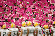 Oct 14, 2012; Houston, TX, USA; Houston Texans fans hold up breast cancer awareness signs during the first quarter against the Green Bay Packers at Reliant Stadium. The Packers won 42-24. Mandatory Credit: Thomas Campbell-thomasgcampbell.com
