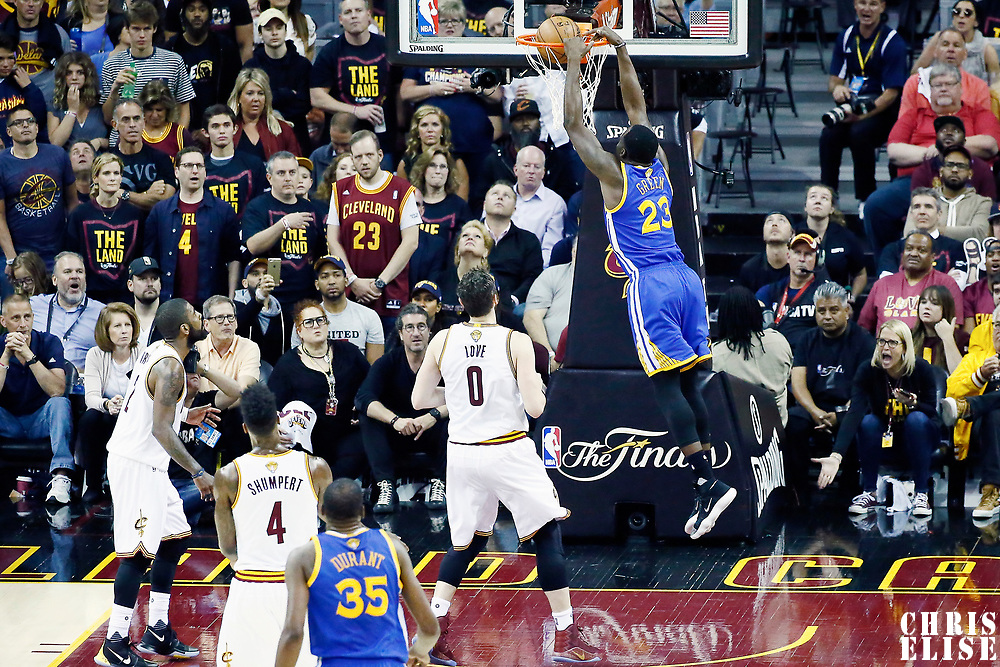 07 June 2017: Golden State Warriors forward Draymond Green (23) dunks the ball on Cleveland Cavaliers forward Kevin Love (0) during the Golden State Warriors 118-113 victory over the Cleveland Cavaliers, in game 3 of the 2017 NBA Finals, at  the Quicken Loans Arena, Cleveland, Ohio, USA.