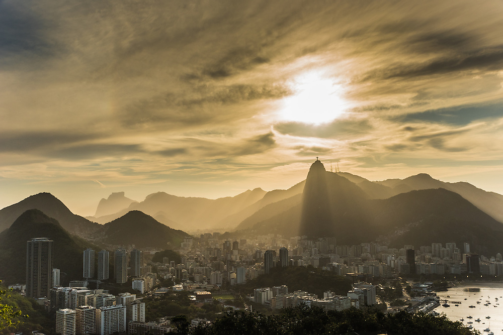 The city of Rio de Janeiro at sunset with on the  background the statue of Christo redentor, Rio de Janeiro, Brazil.
