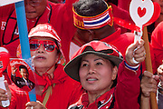 """Mar. 26, 2009 -- BANGKOK, THAILAND: Anti-government protestors in Bangkok. More than 30,000 members of the United Front of Democracy Against Dictatorship (UDD), also known as the """"Red Shirts""""  and their supporters descended on central Bangkok Thursday to protest against and demand the resignation of current Thai Prime Minister Abhisit Vejjajiva and his government. Abhisit was not at Government House Thursday. The protest is a continuation of protests the Red Shirts have been holding across Thailand in March.  Photo by Jack Kurtz"""