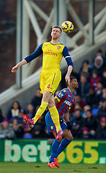 LONDON, ENGLAND - Saturday, February 21, 2015: Arsenal's captain Per Mertesacker in action against Crystal Palace during the Premier League match at Selhurst Park. (Pic by David Rawcliffe/Propaganda)
