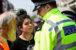 "© Licensed to London News Pictures. 17/04/2019. LONDON, UK.  Police officers request people to move on at Oxford Circus during ""London: International Rebellion"", on day three of a protest organised by Extinction Rebellion, demanding that governments take action against climate change.  Marble Arch, Oxford Circus, Piccadilly Circus, Waterloo Bridge and Parliament Square have been blocked by activists in the last three days.  Police have issued a section 14 order requiring protesters to convene at Marble Arch only so that the protest can continue.  Photo credit: Stephen Chung/LNP"