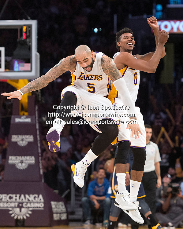 Jan. 4, 2015 - Los Angeles, CA, USA - The Lakers' Nick Young, right, and Carlos Boozer celebrate Young's three-pointer during a game against the Pacers at Staples Center on Sunday.
