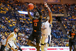 Jan 12, 2019; Morgantown, WV, USA; Oklahoma State Cowboys guard Isaac Likekele (13) shoots during the first half against the West Virginia Mountaineers at WVU Coliseum. Mandatory Credit: Ben Queen-USA TODAY Sports