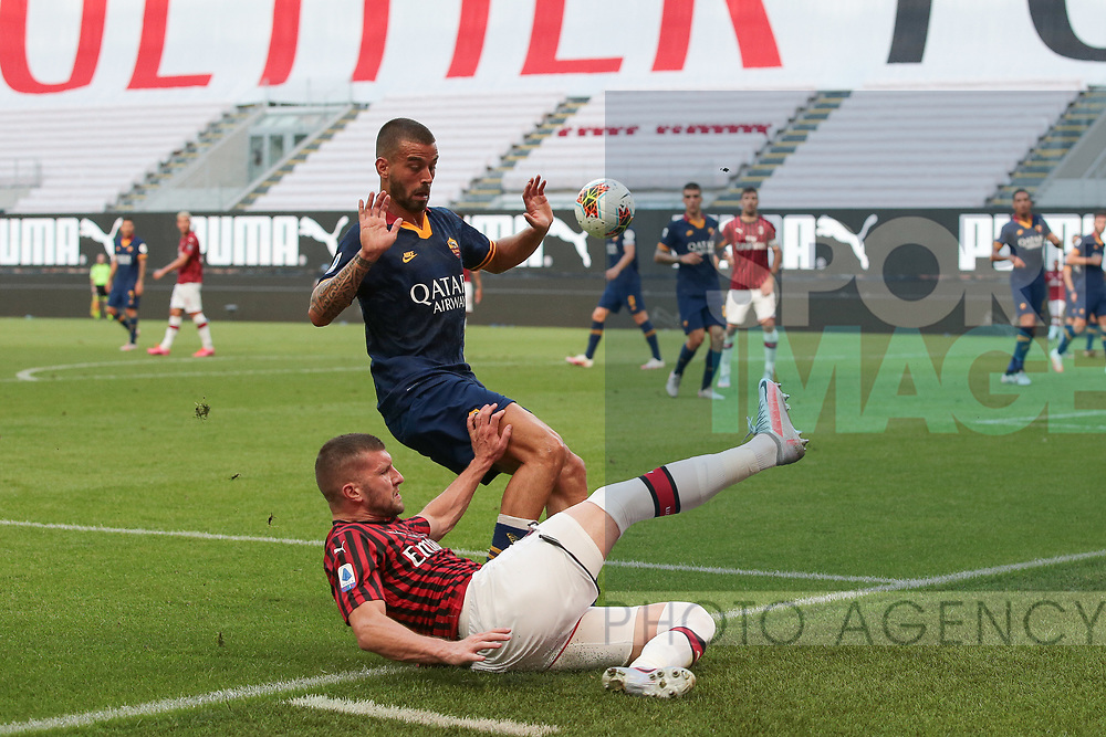 AC Milan's Croatian striker Ante Rebic keeps the ball in play under pressure from AS Roma's Italian defender Leonardo Spinazzola during the Serie A match at Giuseppe Meazza, Milan. Picture date: 28th June 2020. Picture credit should read: Jonathan Moscrop/Sportimage