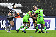 Ospreys' Alun Wyn Jones is tackled by Northampton Saints' Francois van Wyk<br /> <br /> Photographer Craig Thomas/Replay Images<br /> <br /> EPCR Champions Cup Round 4 - Ospreys v Northampton Saints - Sunday 17th December 2017 - Parc y Scarlets - Llanelli<br /> <br /> World Copyright &copy; 2017 Replay Images. All rights reserved. info@replayimages.co.uk - www.replayimages.co.uk