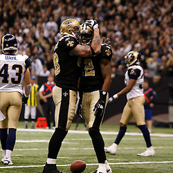 December 12, 2010; New Orleans, LA, USA; New Orleans Saints wide receiver Marques Colston (12) celebrates with tight end Jeremy Shockey (88) following a touchdown during the first quarter against the St. Louis Rams at the Louisiana Superdome. Mandatory Credit: Derick E. Hingle-US PRESSWIRE