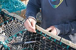 Mending crab pots